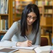 Woman doing some research in the library — Stock Photo