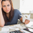 Young woman feeling financial pressure — Stock Photo #23047908