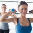 Women lifting weights — Stock Photo