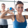 Foto Stock: Women lifting weights