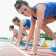 Stock Photo: Happy womat starting blocks