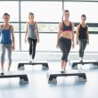 Aerobic group stepping - Stock Photo