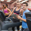 Instructor and woman in the gym — Stock Photo