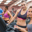 Smiling women in gym — Stock Photo #23048668