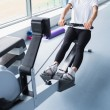 Energetic woman training on row machine — 图库照片