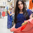 Woman holding clothes - Stock Photo