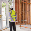 Architect standing in construction site — Stockfoto