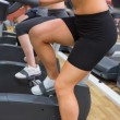 Women on exercise bike — Stockfoto