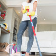 Brunette woman mopping the floor — Stock Photo #23049036