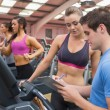 Gym Instructor helping woman — Stock Photo