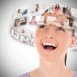 Woman viewing pictures around her head — Stock Photo #23049370