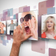 Male hand selecting one photo from digital wall — Stock Photo