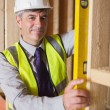 Man checking wooden frame — Stock Photo