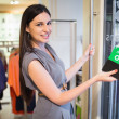 Woman opening clothes store — Stock Photo #23049428