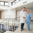 Nurse and doctor standing in hallway — Stock Photo