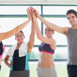 Smiling high fiving each other in gym — Stock Photo #23049626