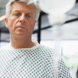 Stock Photo: Sad patient with IV drip