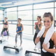Stock Photo: Smiling woman at aerobics class