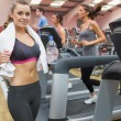 Woman in gym beside treadmill — Stock Photo