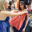 Happy women in clothes store — Stock Photo #23049946