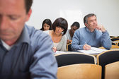 Adult class taking notes — Stock Photo