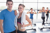 Trainer and woman smiling together while aerobics class taking p — Stock Photo