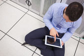 Man with tablet pc in data center — Stock Photo