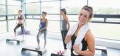 Happy woman taking a break at aerobics class — Stock Photo