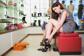 Woman trying black shoes — Stock Photo