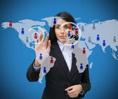 Woman touching blue world map interface — Stock Photo