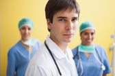 Doctor with two smiling nurses — Stock Photo