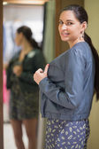 Happy woman in changing room — Stock Photo