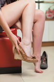 Woman is trying on shoes — Stock Photo