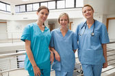 Three nurses leaning against railing — Stock Photo