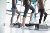 Three women in aerobics class — Stockfoto