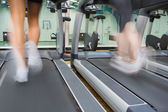 Running on a treadmill in the gym — Stock Photo