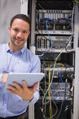 Man with tablet pc in data centre — Stock Photo