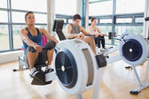 Working out on row machines — 图库照片