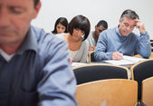 Mature students in lecture — Stock Photo