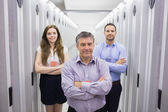Three smiling standing in data center — Stock Photo