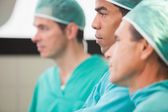Three surgeons thinking — Stock Photo