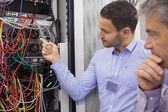 Technicians fixing wires — Stock Photo