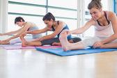 Women stretching in yoga class — Stock Photo