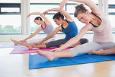 Women stretching on the floor — Stock Photo