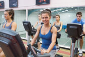 Woman smiling at spinning class — Stock Photo