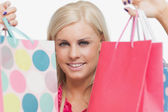 Pretty blonde holding shopping bags — Stock Photo