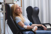 Smiling woman donating blood — Stock Photo