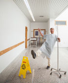 Patient pretending to slip on wet floor — Stock Photo