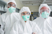 Team of three chemists — Stock Photo