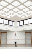 Doctor leaning on the stairwell — Stock Photo